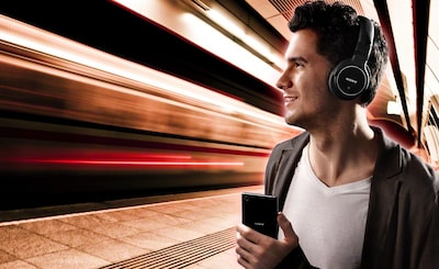 Man wearing Sony's best noise-cancelling headphones