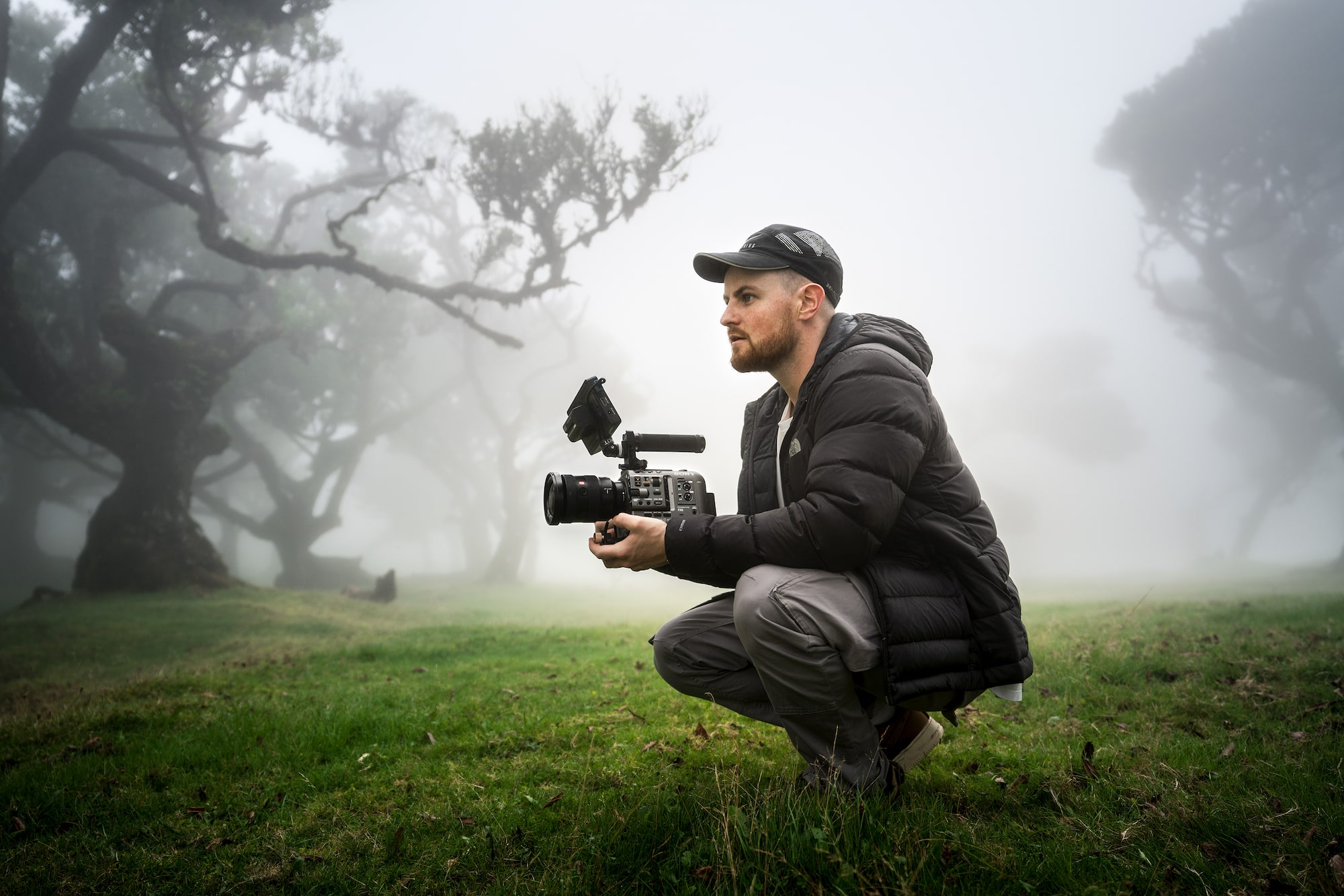 james matthews crouching down in the mist with his sony fx6