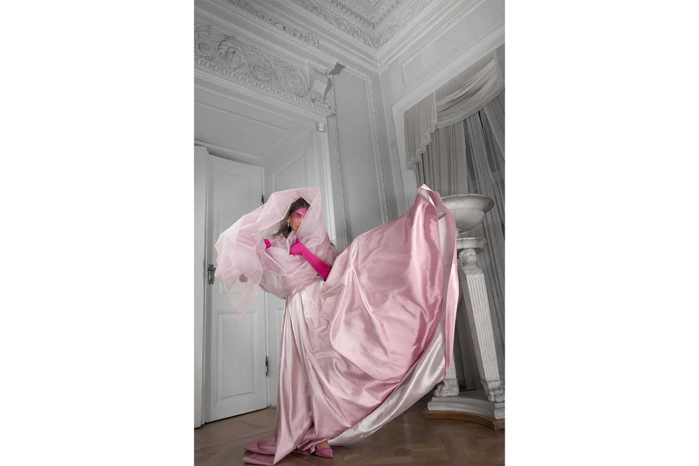 lidia popiel sony alpha 7r3 woman in a pink veil and silky dress raises a leg in a white room