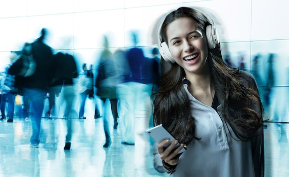 Woman tuning out with noise-cancelling headphones