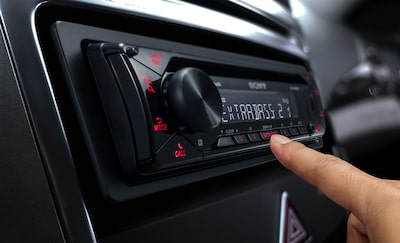 Image of someone pressing a button on the MEX-N4300BT in a dashboard