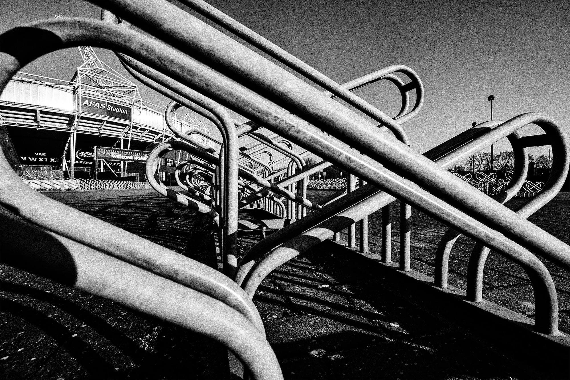 brendan de clercq sony alpha 6600 empty bike racks outside a sports stadium