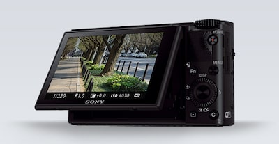 Angled side view of the Sony DCS-RX100 III Cyber-shot digital camera with LCD screen