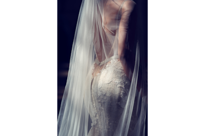 kate-hopewell-smith-sony-alpha-9-rear-shot-of-bride-showing-lace-detail-on-dress