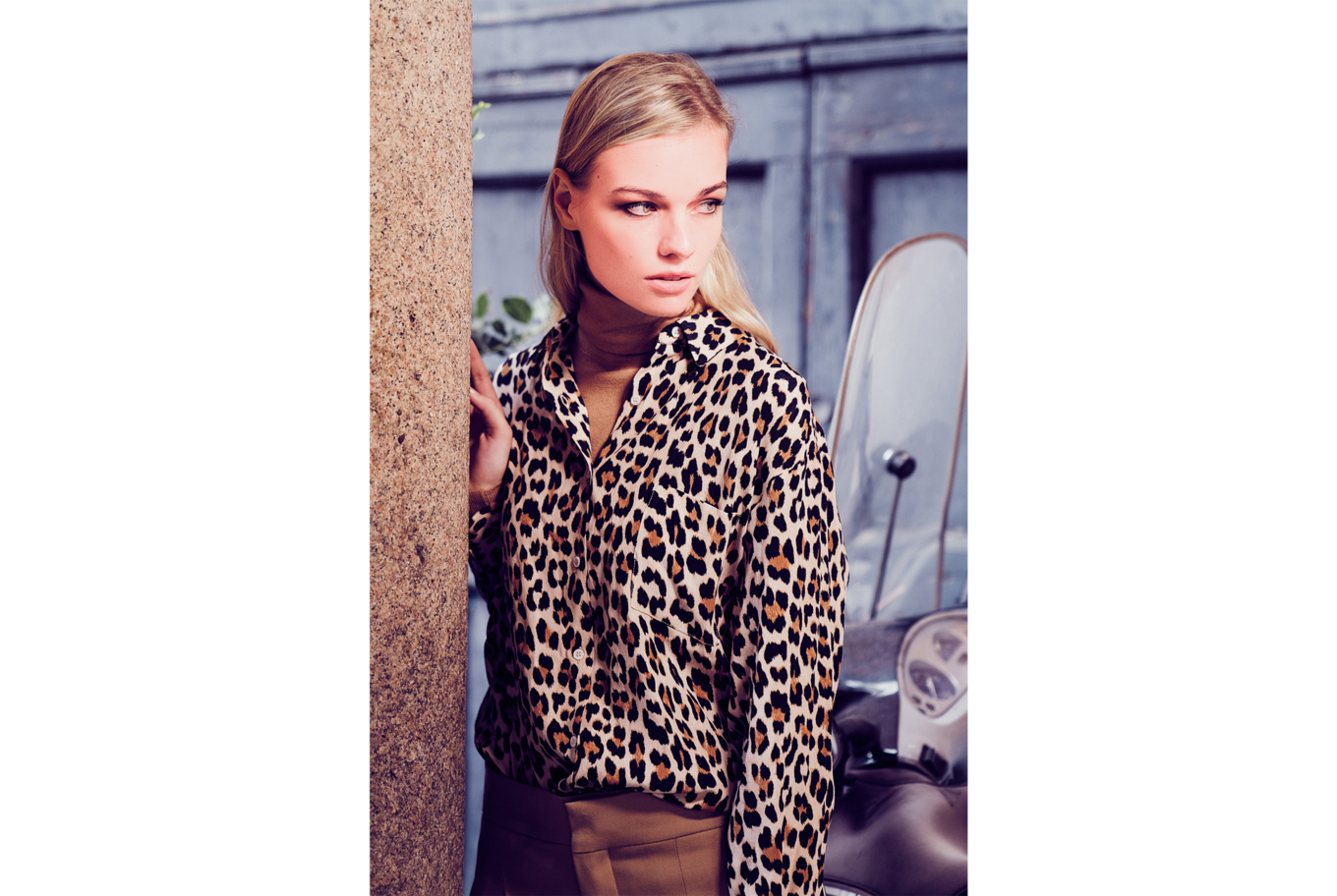 daniel gossmann sony alpha 7RM3 model in leopardskin shirt leans against a wall