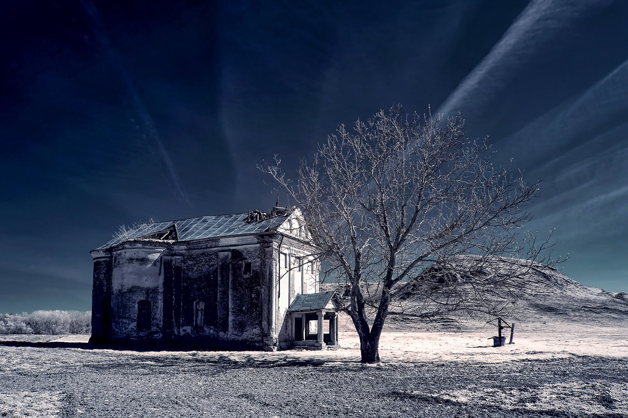 alin popescu sony alpha 6000 infrared shot of a house in the desert with a tree beside it