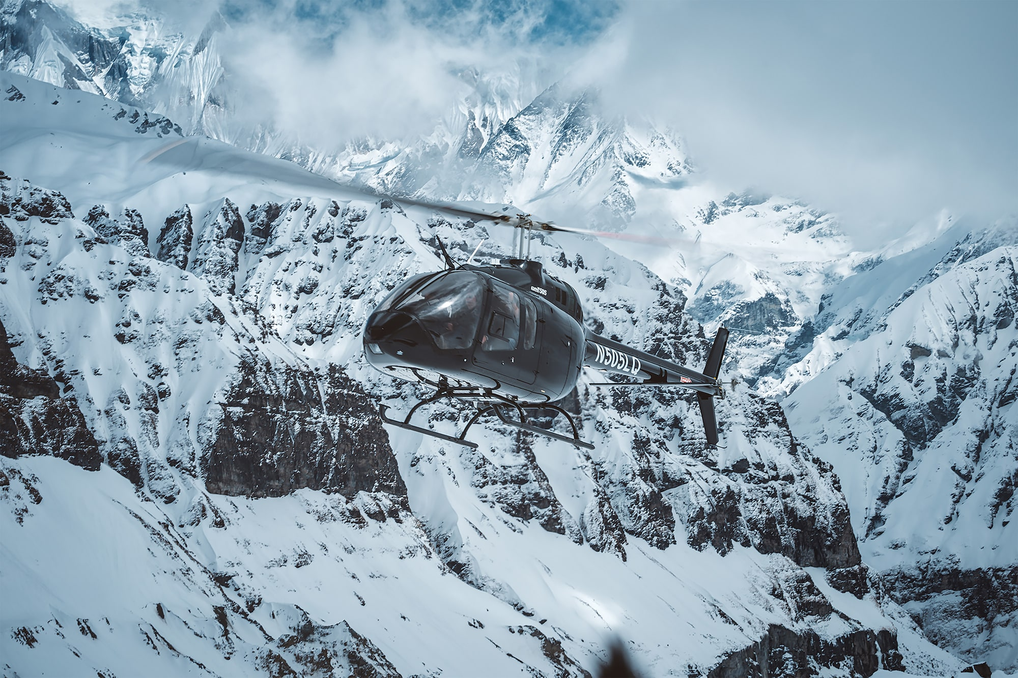 uros podlogar son alpha 9 a black helicopter flying through the himalayas in nepal