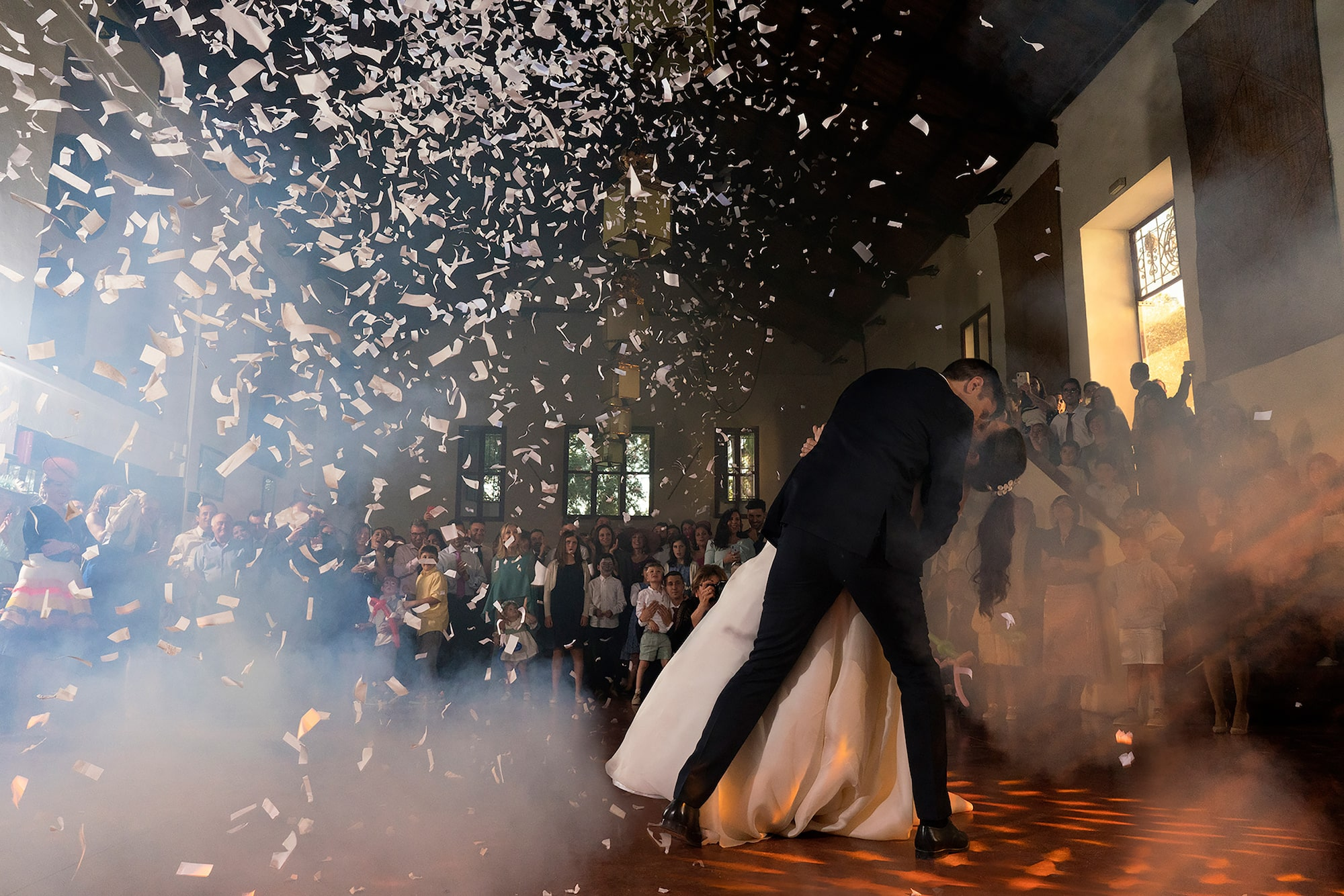 jorge miguel jaime baez sony alpha 7RIII bride and groom kissing on the dance floor as confetti swirls around them
