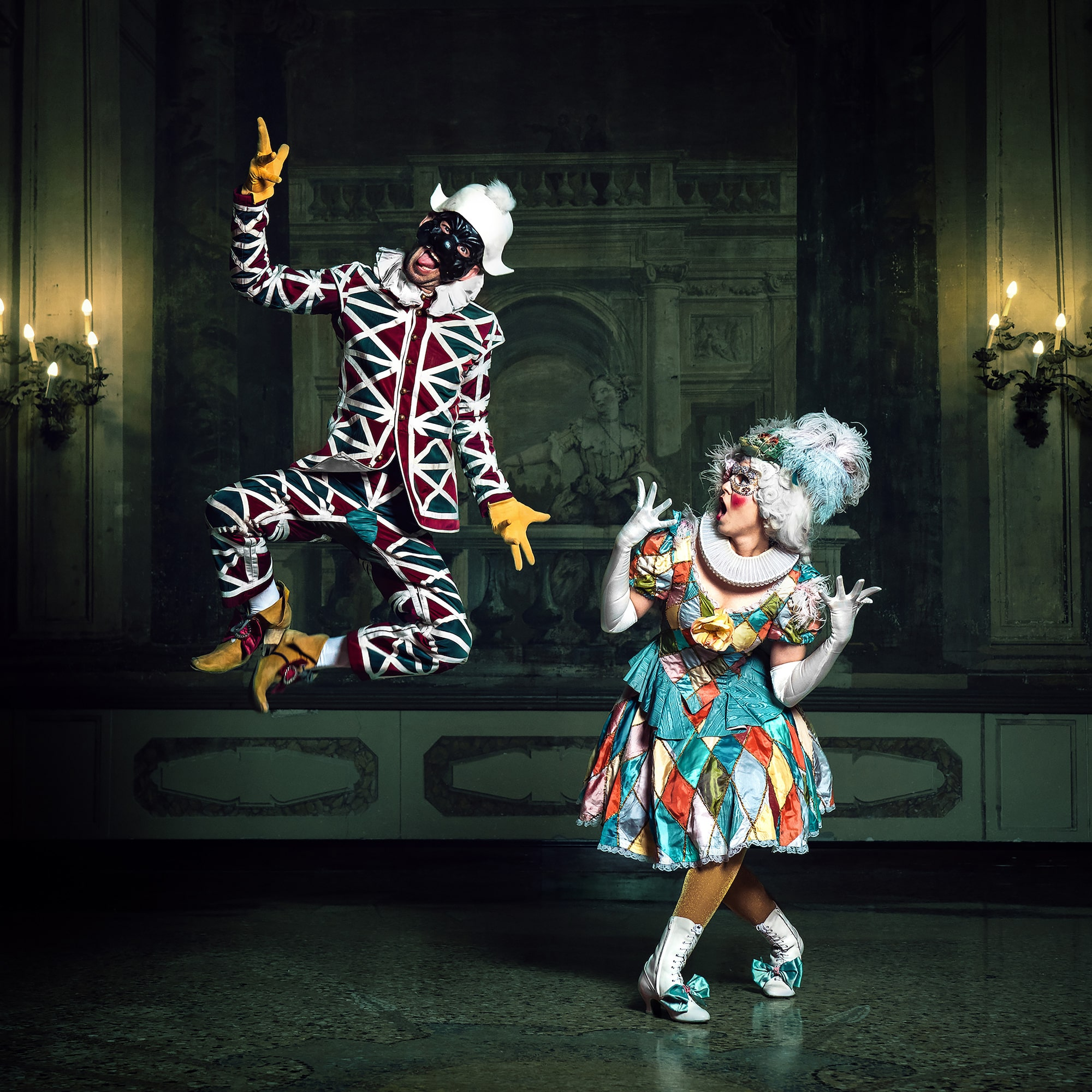 mathias kniepeiss sony alpha 7RIII 2 clowns in costume with one jumping in the air