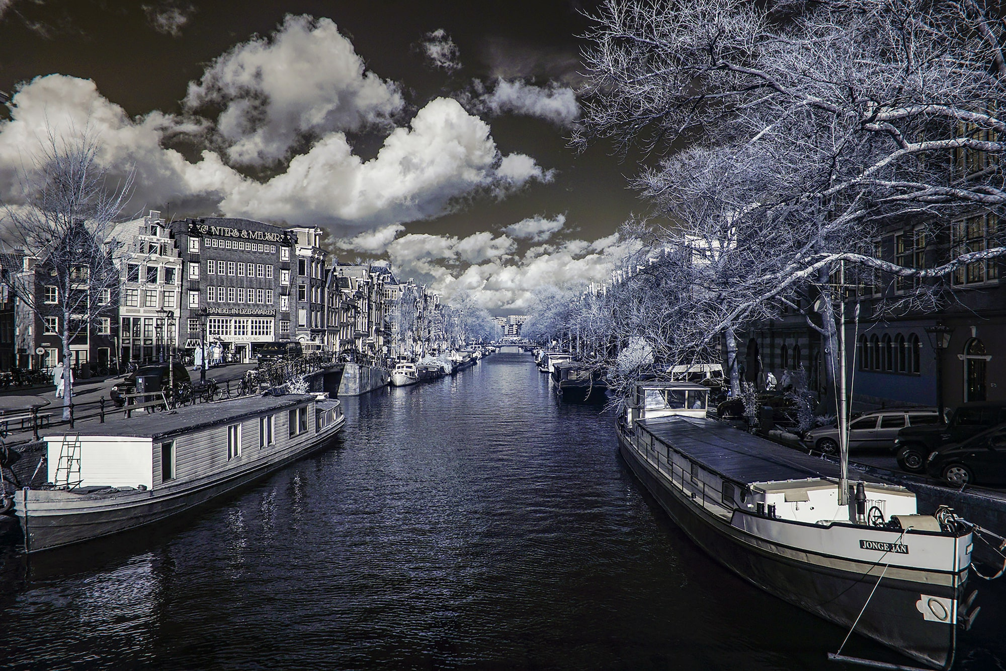 alin popescu sony alpha 600 infrared shot of a canal with a dark sky and fluffy white clouds