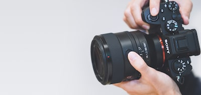 Image of a camera being held vertically with the FE 50 mm F1.2 GM lens attached