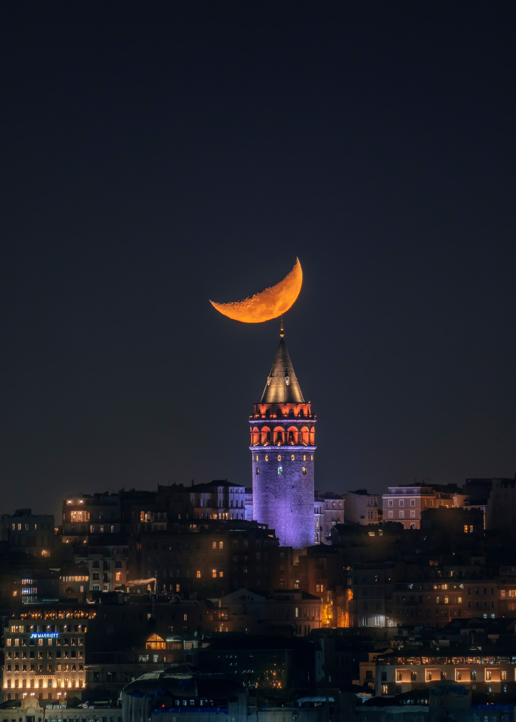 ilhan eroglu sony A6600 a striking crescent moon sitting above a church steeple in istanbul