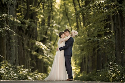 marcis baltskars sony a7rIII bride and groom embracing in a forest framed by trees