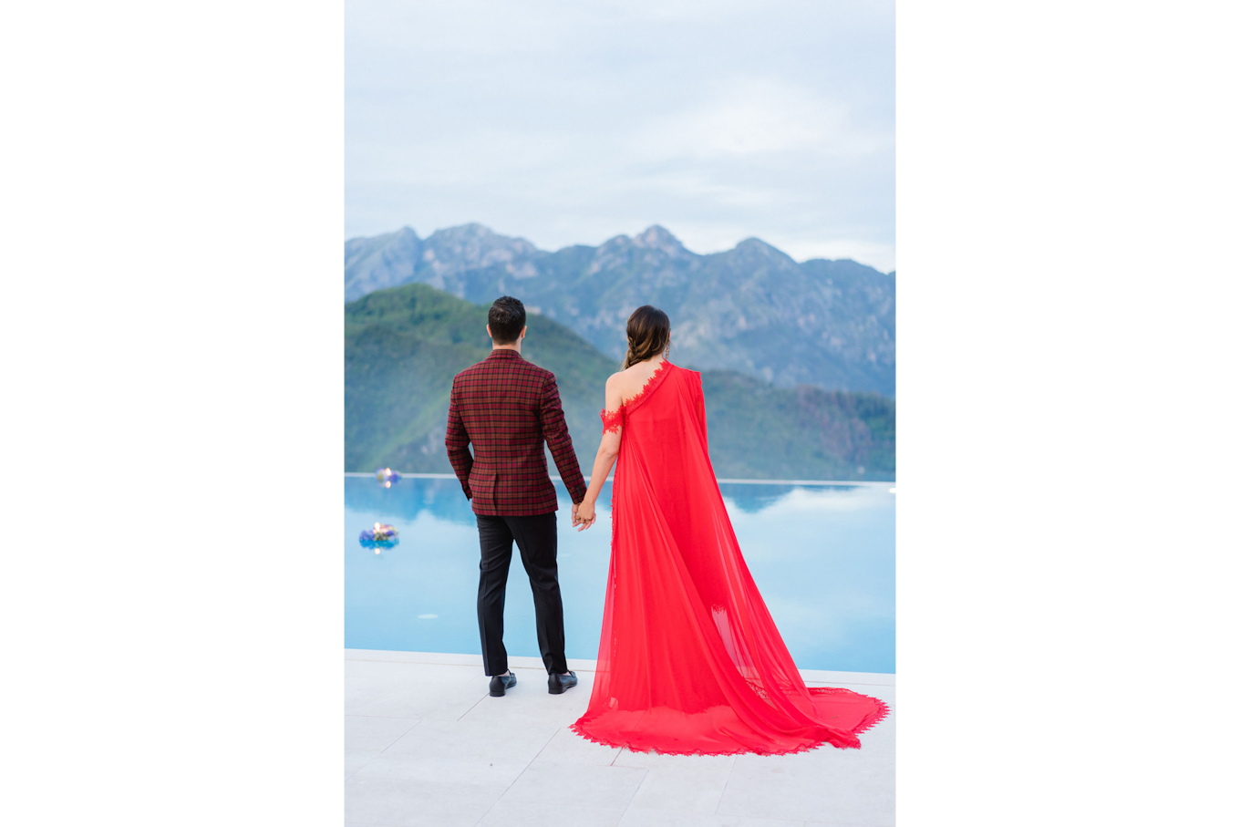 sandra aberg sony alpha 7r3 couple with woman in red dress stands in front of a pool and look at the scenery